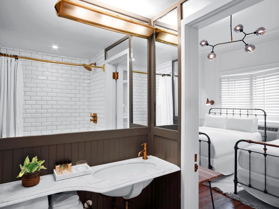 ... Vanities By Watermark; Carrera Marble Countertops; And Antique Bronze  Color Fixtures, Including The Seven Inch Rain Showerheads, By Signature  Plumbing.