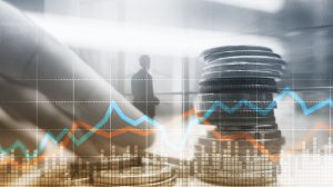 Double exposure of city and rows of coins with stock and financial graph on virtual screen. Business Investment concept