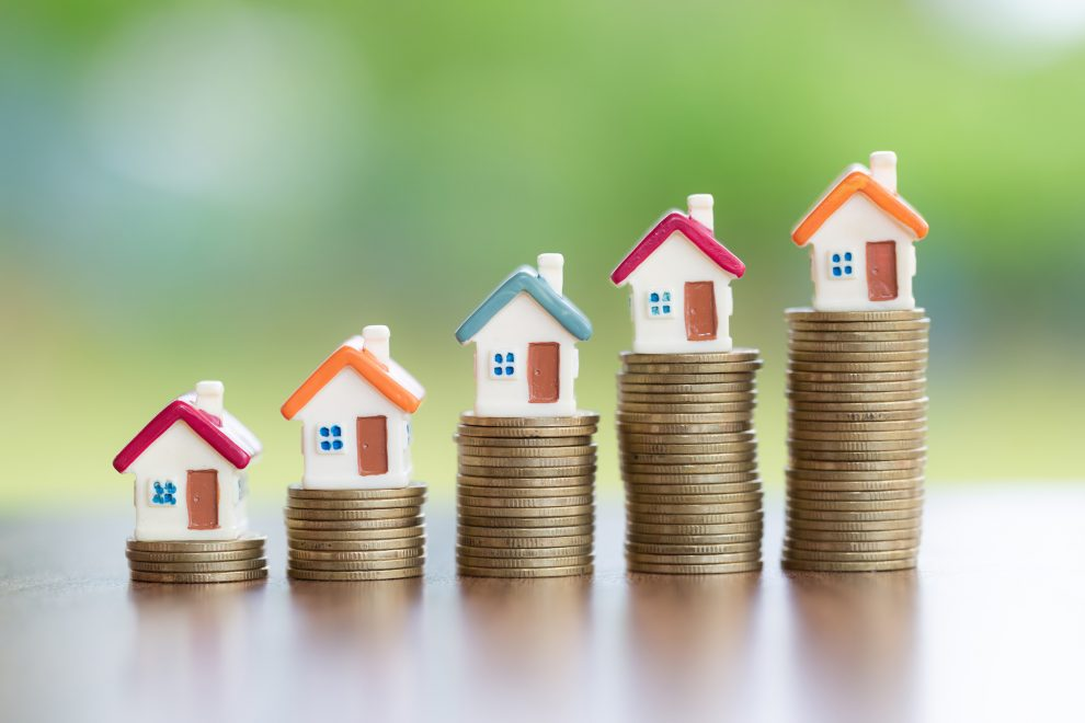 House on the coin, arranged from low to high Concept of starting a business Mortgages and real estate investments Investment for profit.